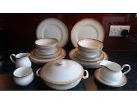 White with gold trim bone China dinner service.