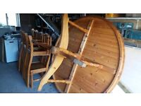 Large round Dining table with ten chairs