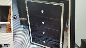 Fenwicks black glass fronted chest of drawers