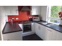 Modern White High Gloss Kitchen Units by Howden