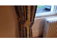 long drop lined curtains with matching tiebacks