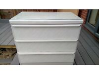 grey chest of 3 drawers with glass top