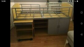 mid sleeper bed with desk, cupboard, shelves and bookcase.