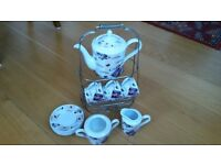Coffee set in porcelain with sugar, milk jug, and caddy
