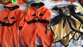 Kids dressing up halloween outfits