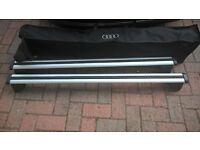 Audi Q5 aluminium roof bars.Original and new. Never used.With bag.