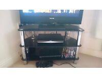 Black glass tv unit and matching dvd shelf unit