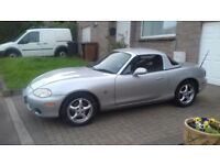 2003 Mazda MX5, 12 months MOT 6 months tax. Hard top for the winter, reliable good runner