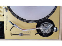 Pair of Technics SL-1200'S MK2 ( silver with gold skins ) and Concorde Q.bert cartridges inc