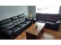 3 seater and 2 seater sofabed black leather in excellent condition