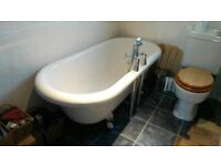 Freestanding roll top bath with mixer taps & hand shower.