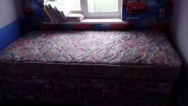 Single divan bed complete with unmarked matress and brand new blue headboard