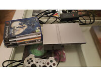 Silver Slimline PS2 console with Games, Controller and Memory Cards