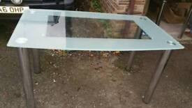 Glass and chrome dining table. New!