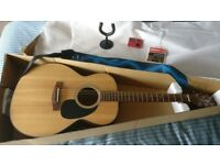 Takamine Acoustic Guitar- as new . Includes leather strap, tuner, spare strings and wall mount