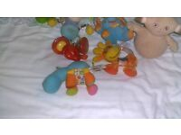 collection of clip on toys for cot or pram