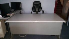 Large White office desk.