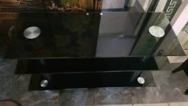 Lovely black glass tv stand very good condition.