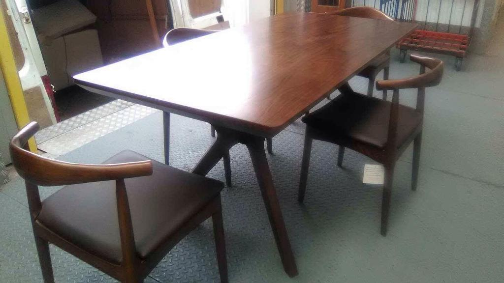 Walnut table and designer chairs