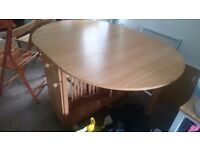 Fold away pine affect dining table and 4 chairs