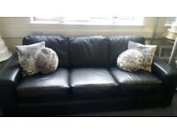 Large black four Seater Sofa for sale