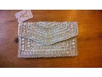 Accessorize silver beaded clutch bag
