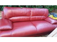 Red leather 3 seater settee - only two years old. Immaculate condition. Buyer to collect. £99