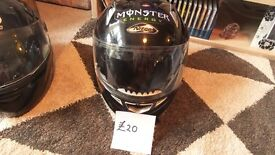2 MOTOR BIKE HELMETS. MONSTER IS A SMALL. THE OTHER IS LARGE.
