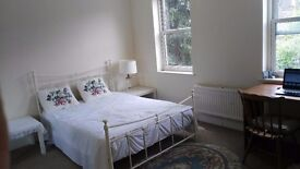 A huge double room in fantastic house wimbledon certral (close wimbledon station )