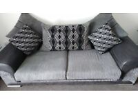 Black 3 seater sofa and swivel chair