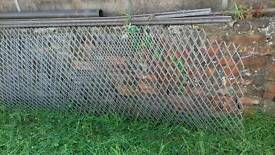 Heavy duty galvanised rigid diamond mesh fencing panels.