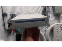 Nintendo Wii Console, inc 3 controllers, motion plus, 11 games balance board we sing etc