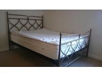 Traditional King size bed frame with spring mattress