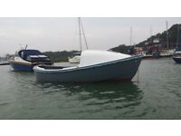 Converted ships life boat, built by Watercraft Gosport. Now an open boat with cuddy