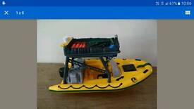 Action man speed boat with extra engine and one bullet