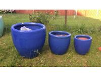 Blue glazed terracotta garden plant pots