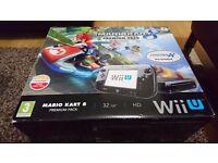 Nintendo Wii U with games.