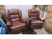 2 brown leather recliner chairs