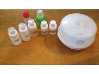 AVENT microwave steriliser + 7 bottles.