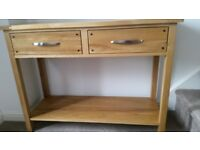 Two drawer solid oak console table.