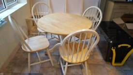 Sabichi round dining table with 4 chairs