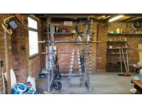 Squat rack with 285kg of plates and, 3 weight bars and sets of 1-10kg of dumbbells