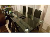 Large glass dining table with 2x chairs