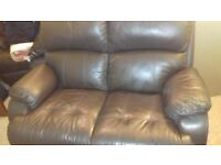 two seater leather suite comprising of 2 chairs 1/manual 1 -electric recliners good condistion