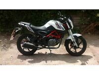 ksr moto grs 125 2016 excellent condition 2350 miles comes with lock,helmet and cover