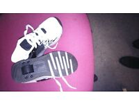 """Kids """"heeley"""" type trainers suitable for boys or girls. Retractable wheels with flashing lights"""