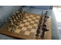 Wooden chess board and metal pieces