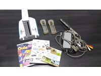 NINTENDO WII with stand and games