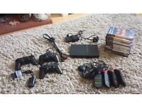 PlayStation 2 + 3 controllers, 11 games and Buzz Controllers x4
