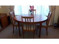 Excellent condition dining table and four chairs.